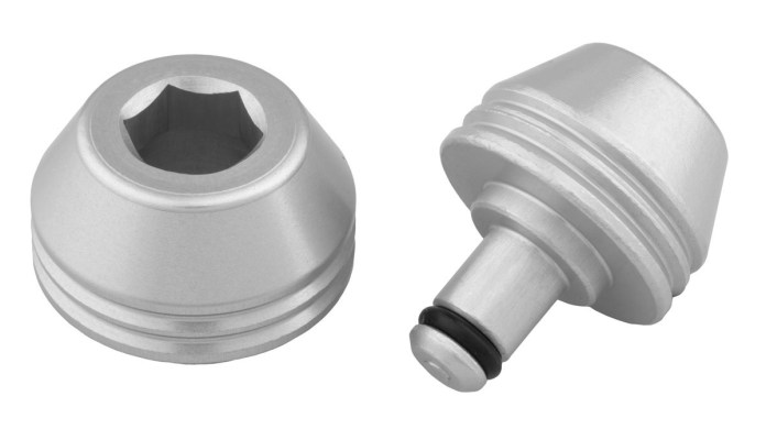 Replacement rear thru axle with axle cap for frame protection or trainer caps for indoor trainer use.
