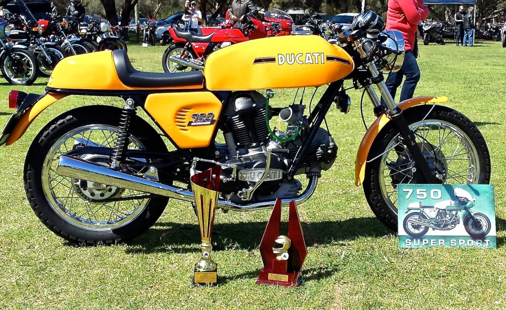 CAPTION: Danny Mitchell's stunning 1973 Ducati 750 Sport won our informal 'Bike Of The Show' award, and some real trophies too.