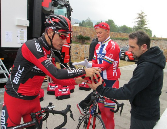 Past world road champions Philippe Gilbert (left) and Thor Hushovd (center) get assistance from soigneurs like Stefano Rubino before the day's training ride. (Photo by Sean Weide, BMC Racing Team.)