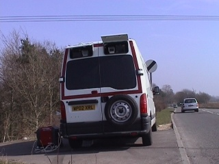 23Mar03 - surveillance van recording vehicle registrations and possibly biometrics on the A417 west of Fairford, Gloucestershire, UK.