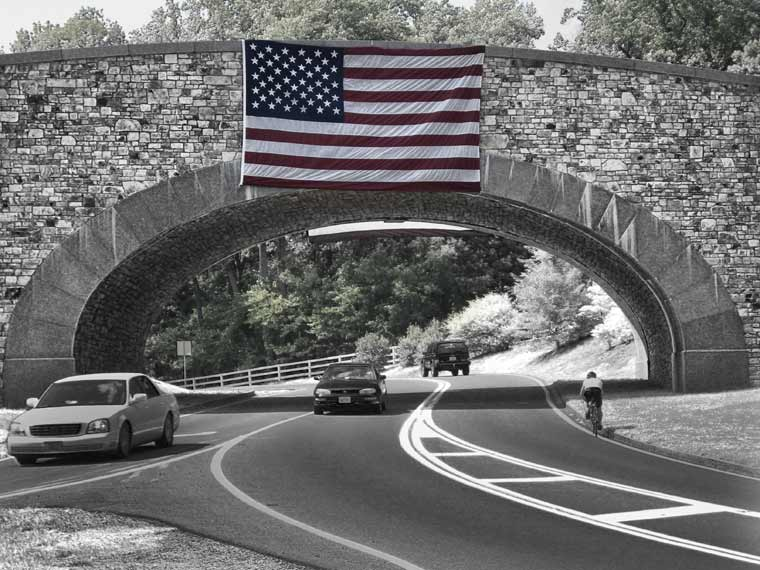 U.S. flag displayed over Virginia Route 53, the road to Monticello, Jeffersons home in Virginia, 2008 - Photo by Emory