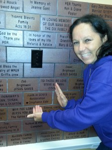 Listener finding their brick on The Legacy Wall