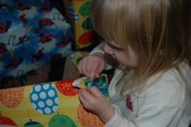 Ada opening her gift.