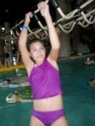 Helena swinging across the pool.