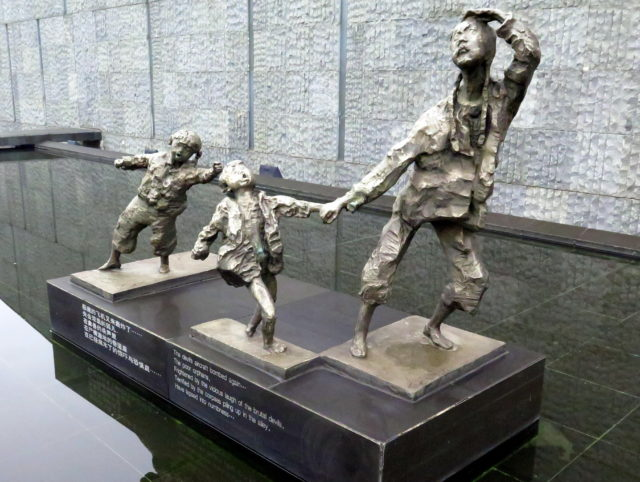 Sculpture of suffering citizens at the Nanjing Massacre Memorial Hall. Nanjing, China, Asia.