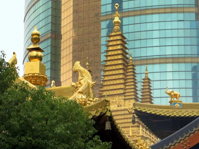 Golden rooftop features of Jing'an Temple. Shanghai, China, Asia.