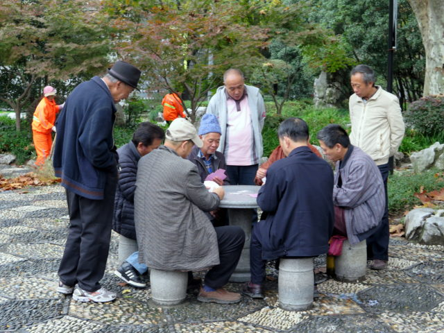 In Fuxing Park, old men playing cards by the trees. Oh, if only they had been playing Chinese checkers, in the rain. (If you don't get it, look it up.) French Concession, Shanghai, China, Asia.
