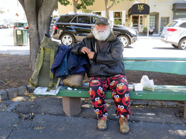 I complimented this Washington Square regular on his pants, gave him a donation, and asked to take his picture. He looked very dignified. San Francisco, United States, North America.