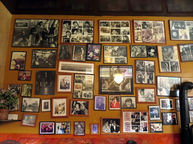 Old photos on the wall inside Caffè Trieste. San Francisco, United States, North America.