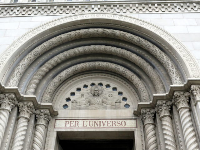 Beautiful detail on the main portico of Saints Peter and Paul Church. The inscription is a snippet of a quote from Dante that runs across the facade. San Francisco, United States, North America.