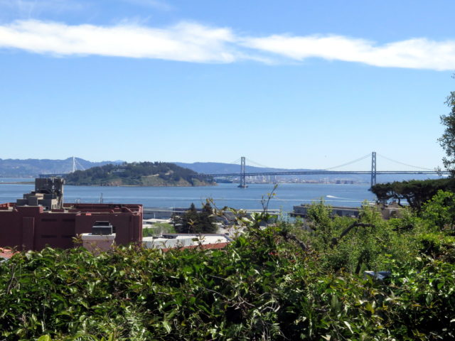 The Bay Bridge, reaching across to Oakland, passing through Yerba Buena Island along the way. San Francisco, United States, North America.