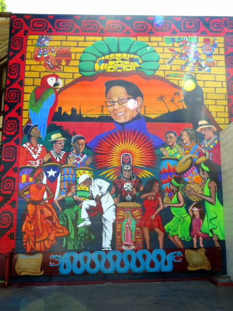 There's lots of dancing going on in this mural. It's dedicated to Chata Gutierrez. She was a legendary salsa DJ, and she championed Latin music being played on San Francisco radio. San Francisco, United States, North America.