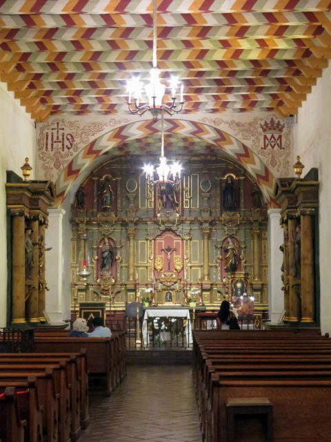 The interior of Mission Dolores's church is surprisingly detailed considering that the exterior is quite simple. The ceiling is painted in a design created by the Ohlone, the original native inhabitants of the region. San Francisco, United States, North America.