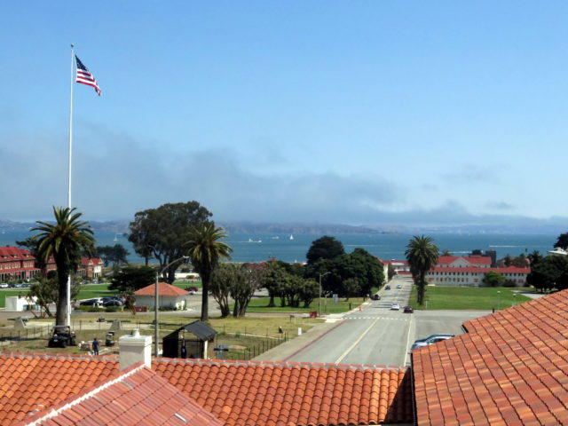 The view across the Presidio's Main Post to San Francisco Bay from a balcony at the Officers' Club. San Francisco, United States, North America.