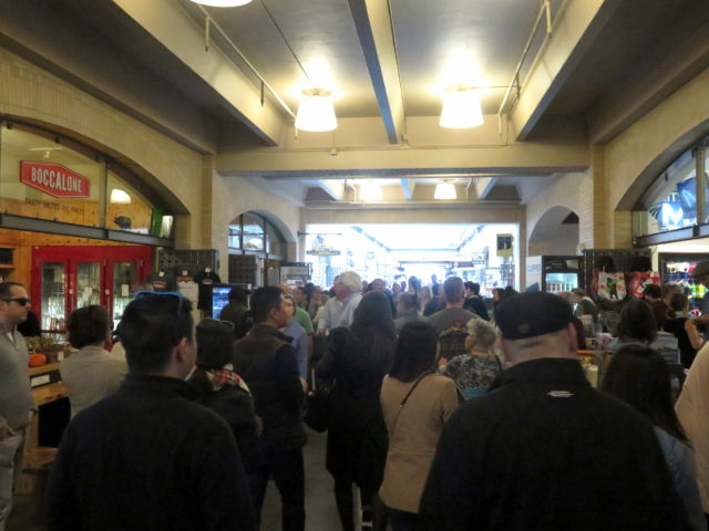 Tourists (and some locals) pack the food hall on the 1st floor of the Ferry Building. San Francisco, United States, North America.