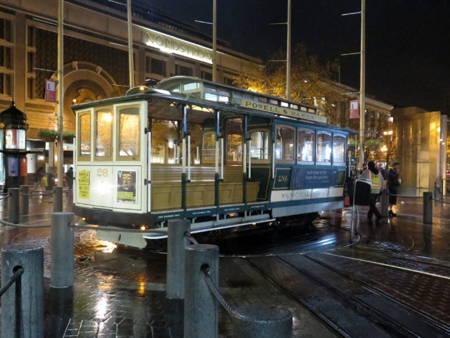 Museums are cool, but ain't nothing like the real thing, baby! A Powell-Mason car spinning around on its turntable at Powell & Market. San Francisco, United States, North America.