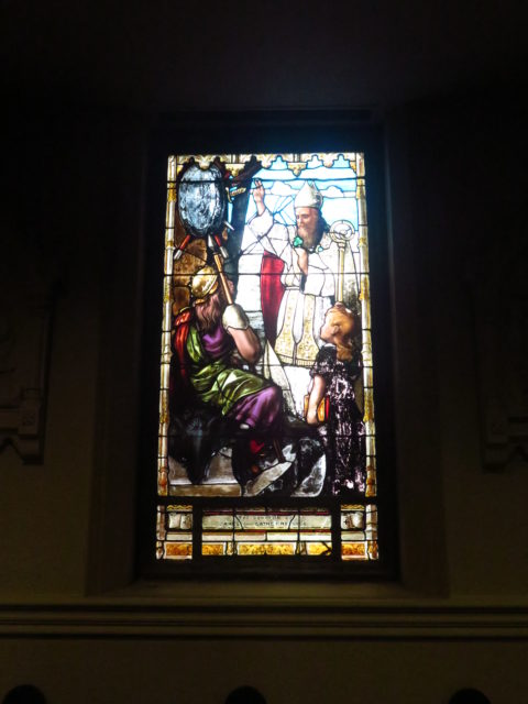 St. Patrick gives a blessing on a stained-glass window in Old St. Mary's in Chinatown. San Francisco, United States, North America.
