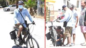 Bisikleti bozulunca yolda kalan Şener Şen'in yardımına esnaf koştu