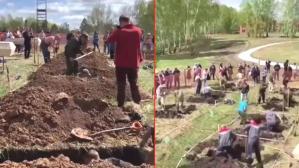 Koronayla mücadele eden Rusya'da tepki çeken olay! 'Hızlı mezar kazma' yarışması düzenlediler