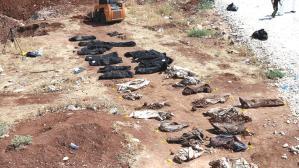 Afrin'de bulunan toplu mezardan çıkarılan cansız beden sayısı 68'e yükseldi