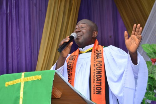 A blind student of Bina Foundation, Revd. Ben Ugwu delivers sermon at Church of Transfiguration