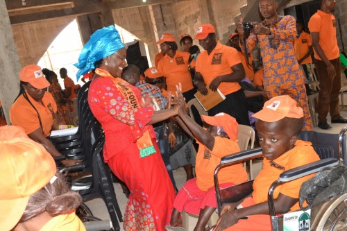 Bina president dances at the church service with the special needs students