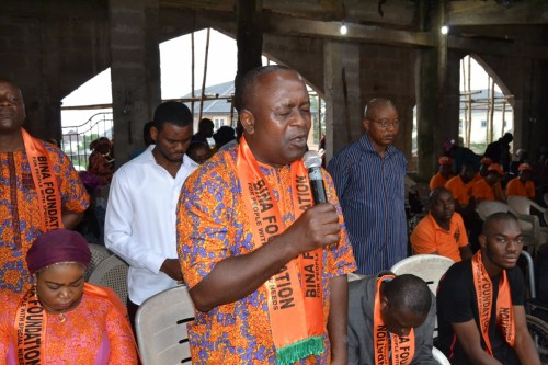 Hon. Chikwendu Amobi, Bina Foundation volunteer, leads in a prayer session