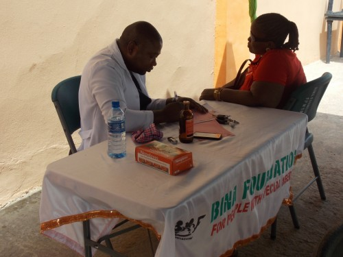 Medical doctor attends to one of the patients during the event