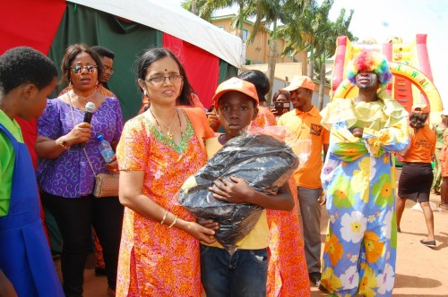 One of the volunteers Mrs. Sundara gifts a child with a school bag