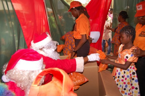 Orphans and vulnerable children queue up to receive gifts from Santa Claus during the Christmas party 13