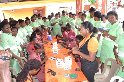 Students with visual and physical disabilities surpise the student nurses at the bead and wirework department