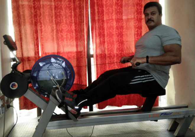 Manjuanth TP demoing the indoor rowing equipment