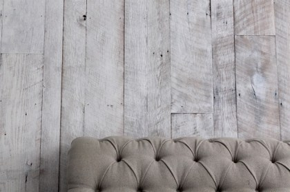 Reclaimed Brown Barn Board paneling with a white washed look.