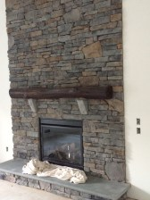 Thiis reclaimed beam is stained using a dark color and finished before it was installed.