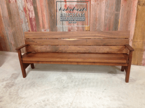 This bench is made from reclaimed walnut and is finished with a clear tung oil finish.