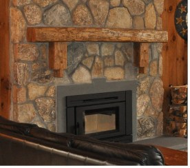 Live Edge Mantel mounted on a stone fileplace