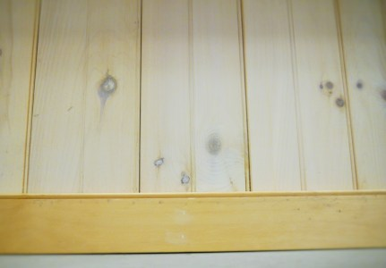 Knotty Grade Edge and Center Bead paneling with a white wash finish