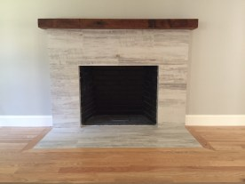 Reclaimed Beam Mantel on a Clean Modern Fireplace