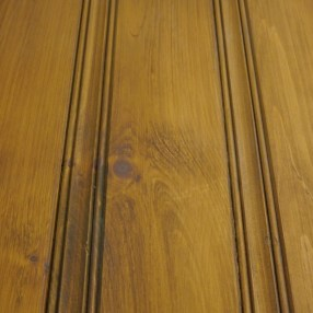 The pickwick pine paneling wall in our showroom is stained with a base coat.