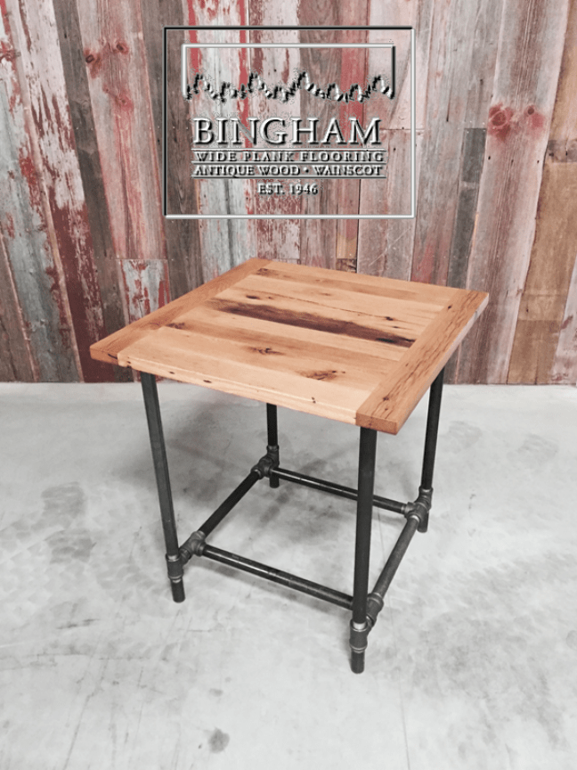 This reclaimed oak top sits nicely on the iron pipe legs at a bar top height.
