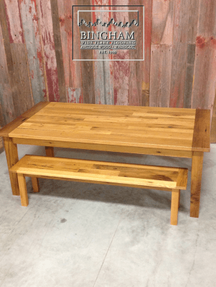 This table was made with two matching benches which add a great touch to the table. Made custom so they tuck neatly under the table these benches are a great touch.