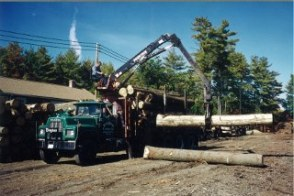 Moving logs with one of Bingham's old trucks