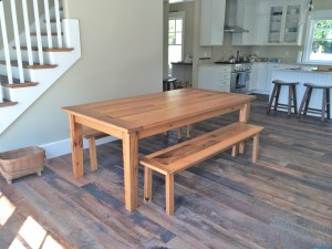 Pictured one of our custom made Reclaimed Oak Dining tables with two matching benches.