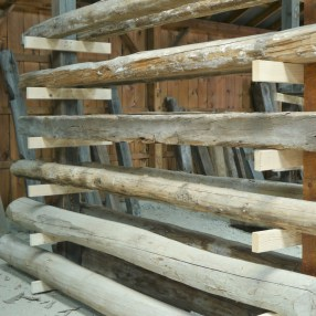 Reclaimed barnwood beams in our reclaimed beam annex