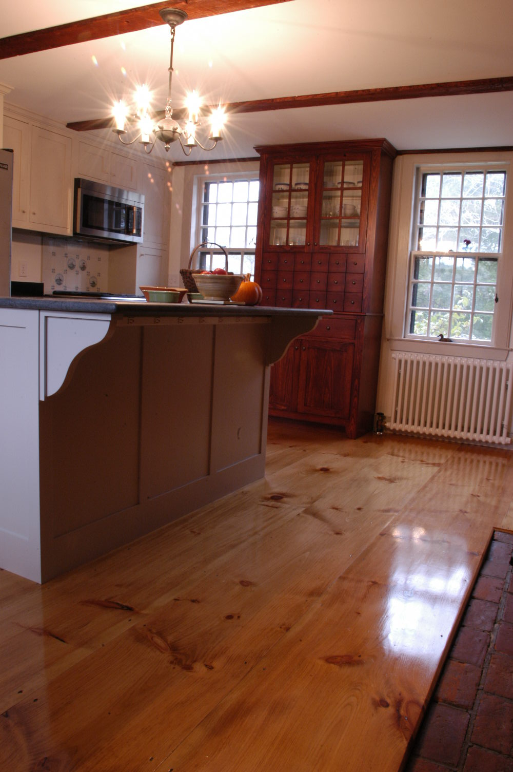 wide plank pine flooring in a rustic knotty grade pine