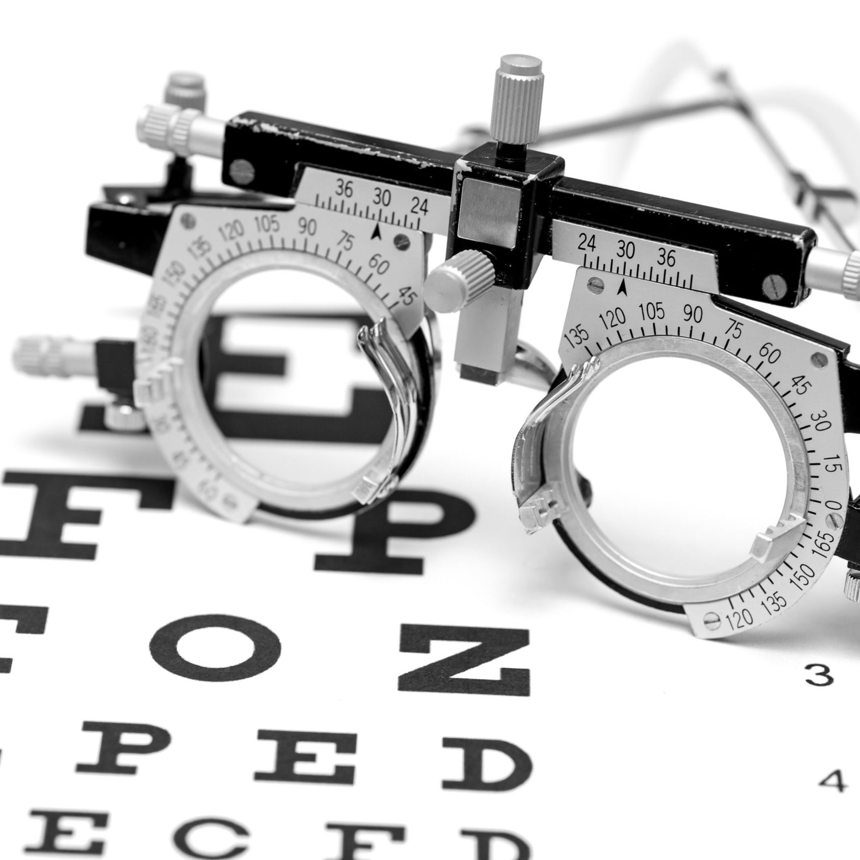 trial lens on a letter eye chart