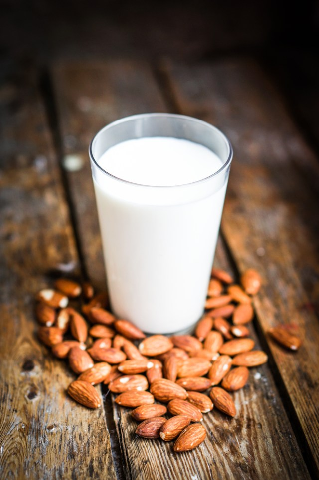 almond milk on wooden table