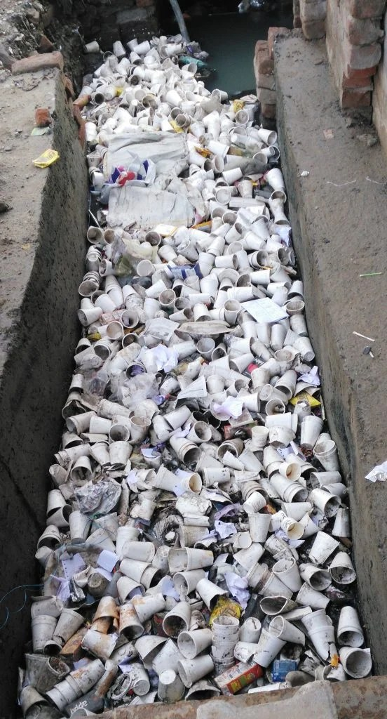 A municipal drain choked by garbage in north Indian city of Aligarh