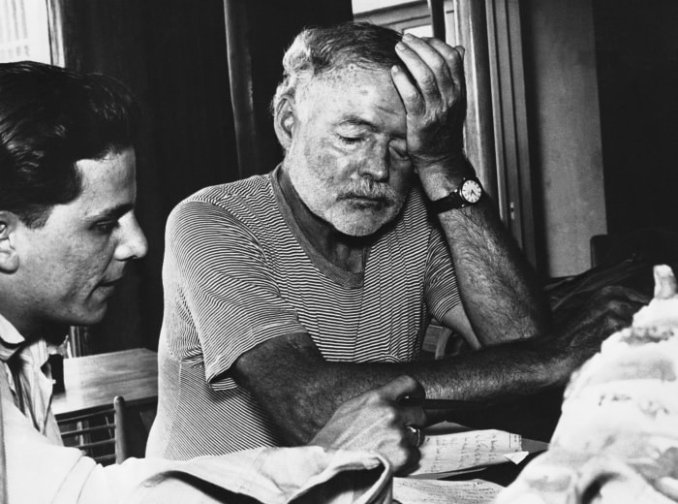 Ernest Hemingway rests his head after supervising filming of the big screen version of his novel The Old Man and the Sea