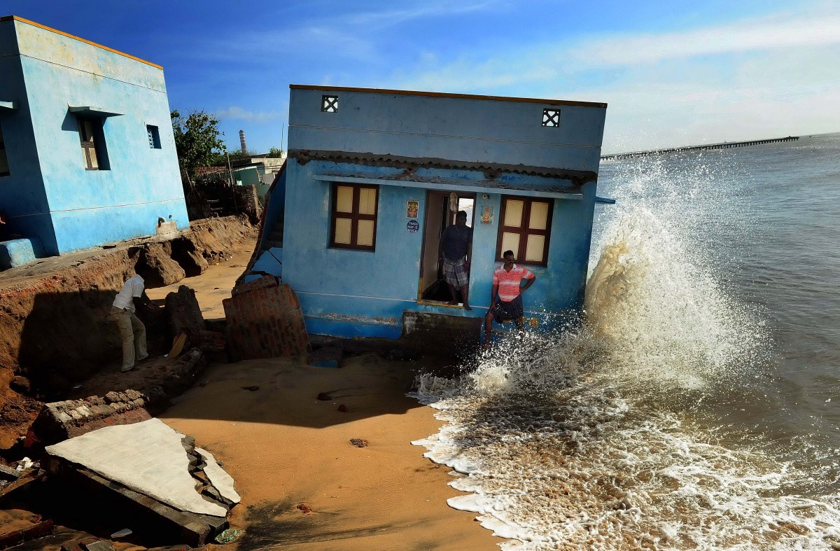 Double Disaster: Houses of tsunami survivors being washed away in sea erosion in Ennore near Nettukuppam in Chennai. pic by S L Shanth Kumar